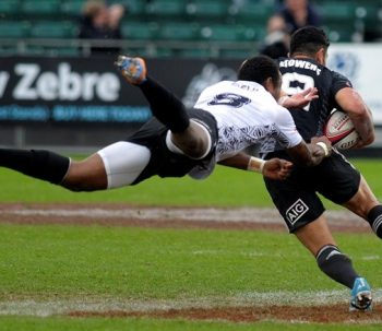 Fiji's Osea Kolinisau tackles Sherwin Stowers during the Rugby Union Glasgow Sevens Cup Semi Final match against New Zealand, part of the IRB Sevens World Series, at Scotstoun Stadium in Glasgow, Scotland, on May 4, 2014. AFP PHOTO / ANDY BUCHANAN